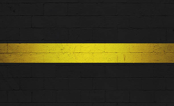 Thin Gold Line Flag painted on a wall stock photo
