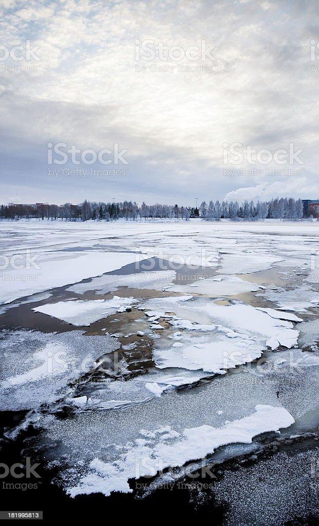 Thin ice on a lake at sunrise stock photo