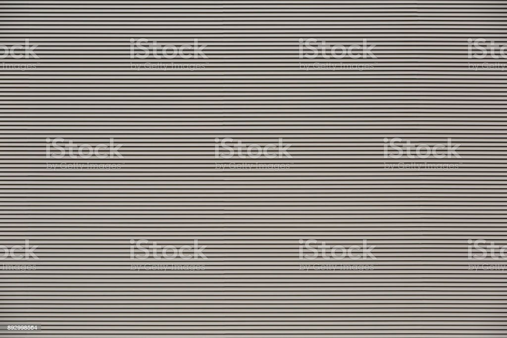Thin metal horizontal louvers as background or backdrop stock photo