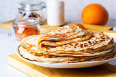 istock Thin pancakes on white rustic table 1189351815