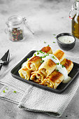 istock Thin pancakes with fillings. Russian Fried Stuffed Pancakes 1155233561