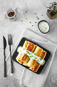 istock Thin pancakes with fillings. Russian Fried Stuffed Pancakes 1155233738