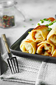istock Thin pancakes with fillings. Russian Fried Stuffed Pancakes 1155274503