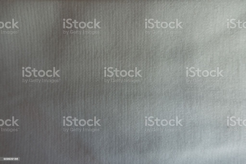 Thin simple white jersey fabric from above stock photo
