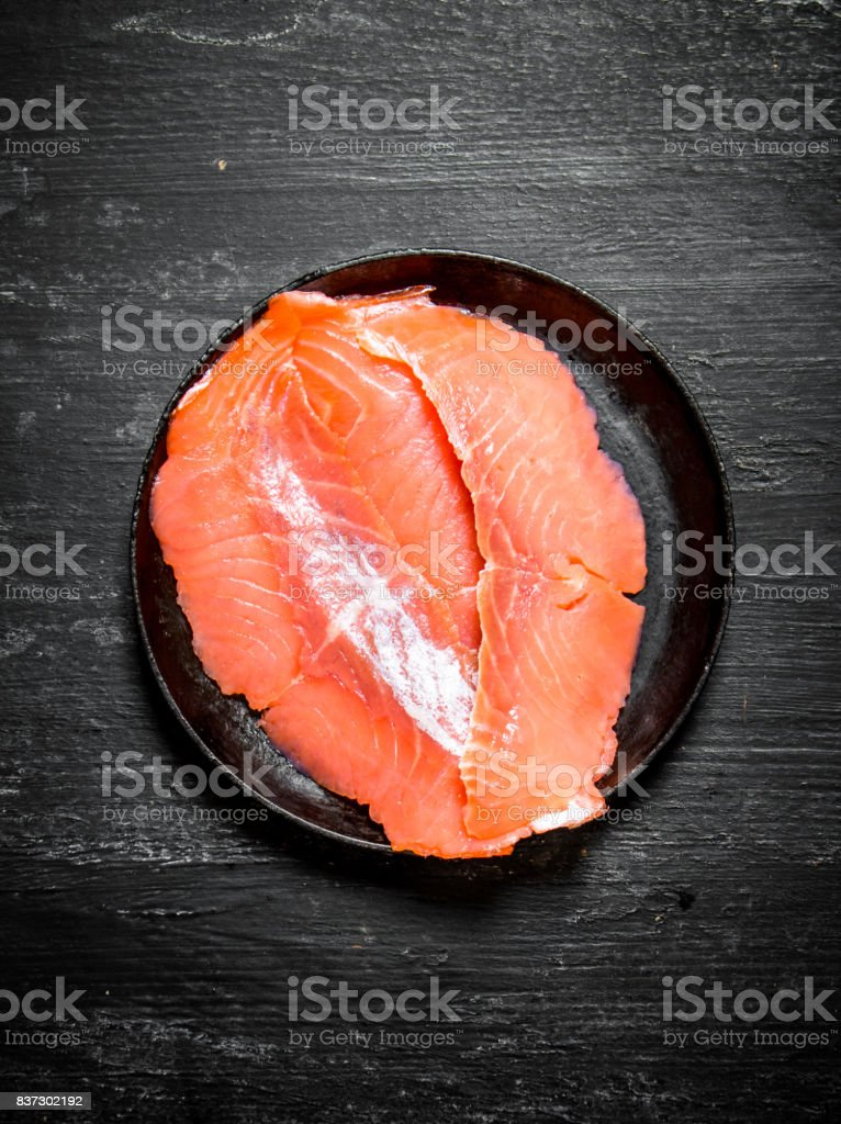 Thin Slices Of Salmon In The Old Plate Stock Photo