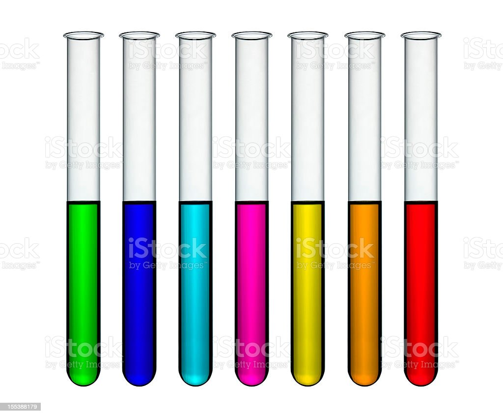 Thin test tubes with rainbow colored liquids royalty-free stock photo