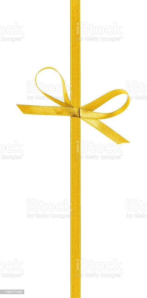 thin yellow bow with vertical ribbon stock photo