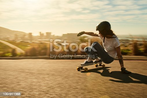 Shot of a young woman out on her skateboard