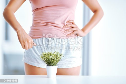 Cropped shot of an unrecognizable woman trimming a plant