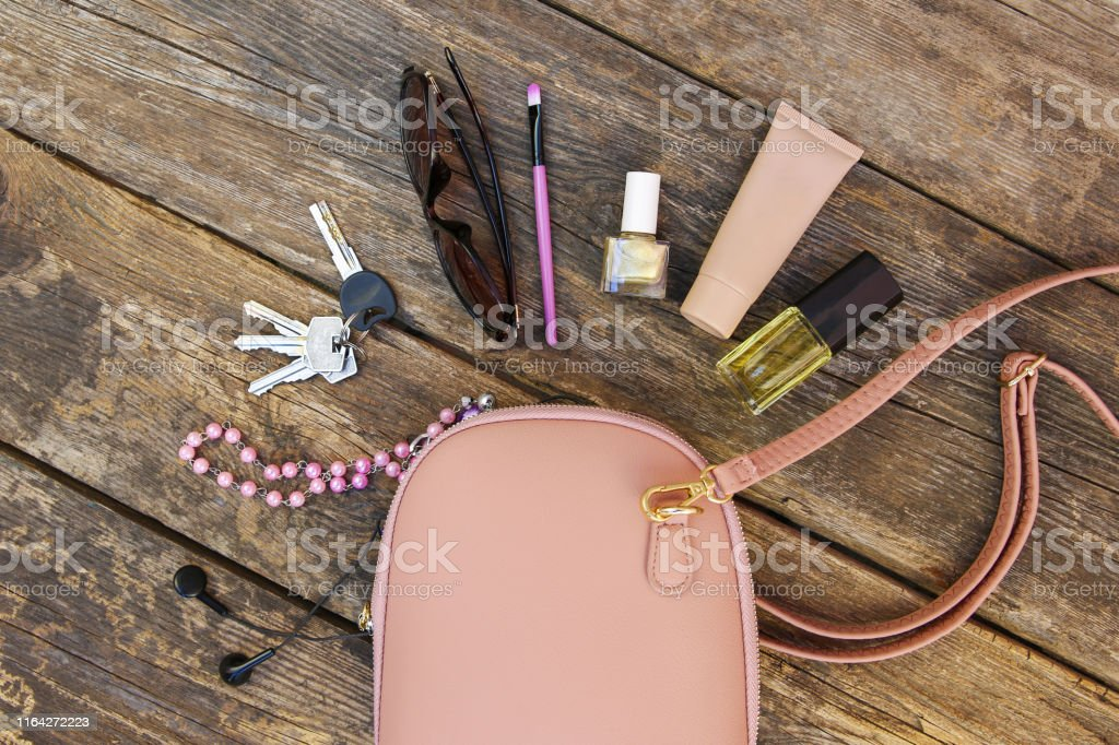Things from open lady purse. Cosmetics and women\'s accessories fell...