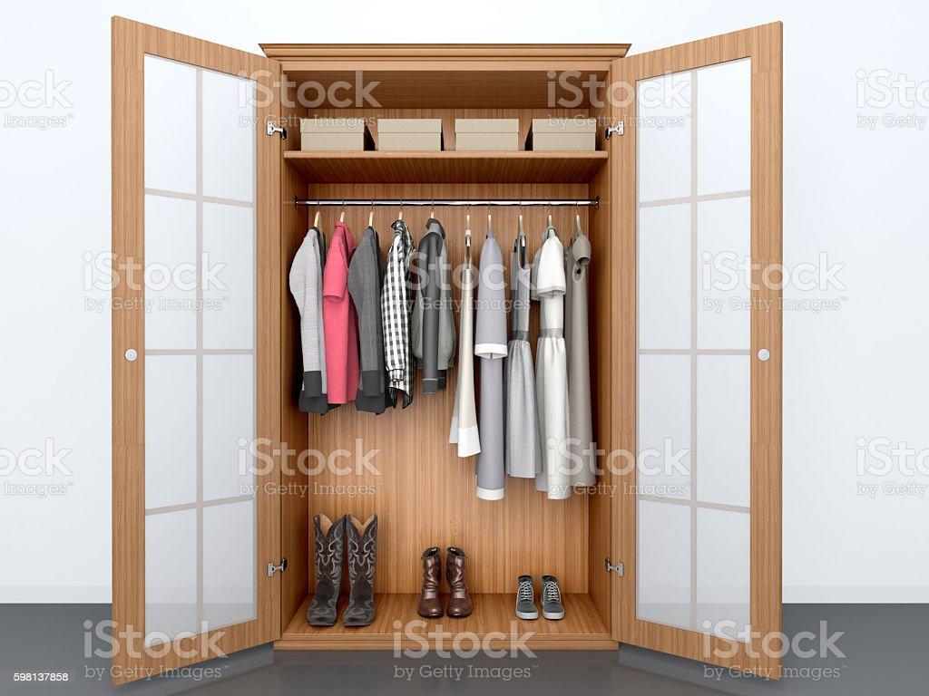 things in an open wooden cabinet. - foto de stock