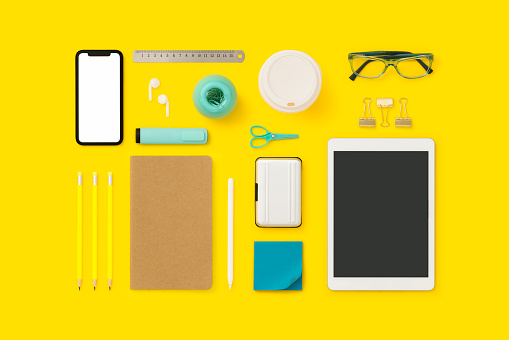 Things on my desk flat lay. Back to school flat lay on yelow background.