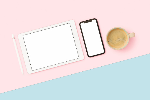 Things on my desk flat lay on pink and blue background