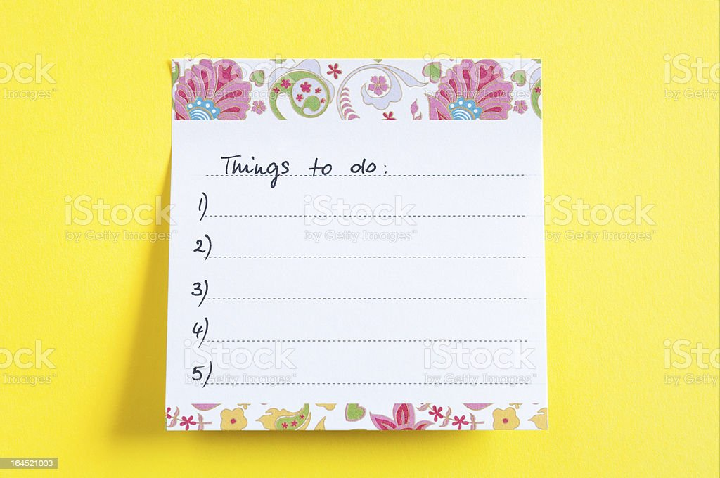 Close up of a sticky note saying Things To Do list - yellow background