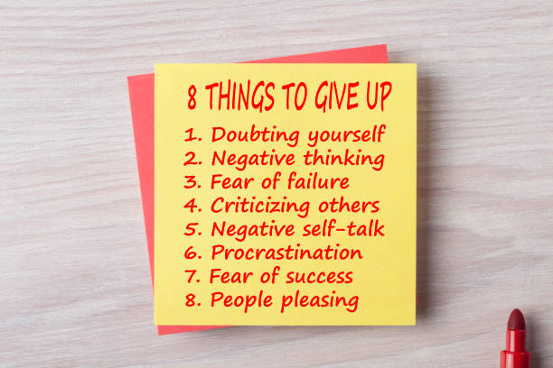 8 Things To Give Up written on note concept stock photo