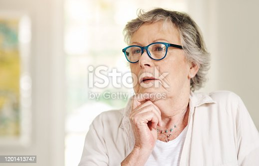 Shot of a senior woman looking thoughtful at home