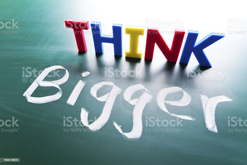 Think bigger concept royalty-free stock photo
