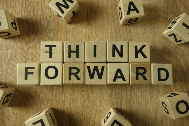Think forward text from wooden blocks stock photo