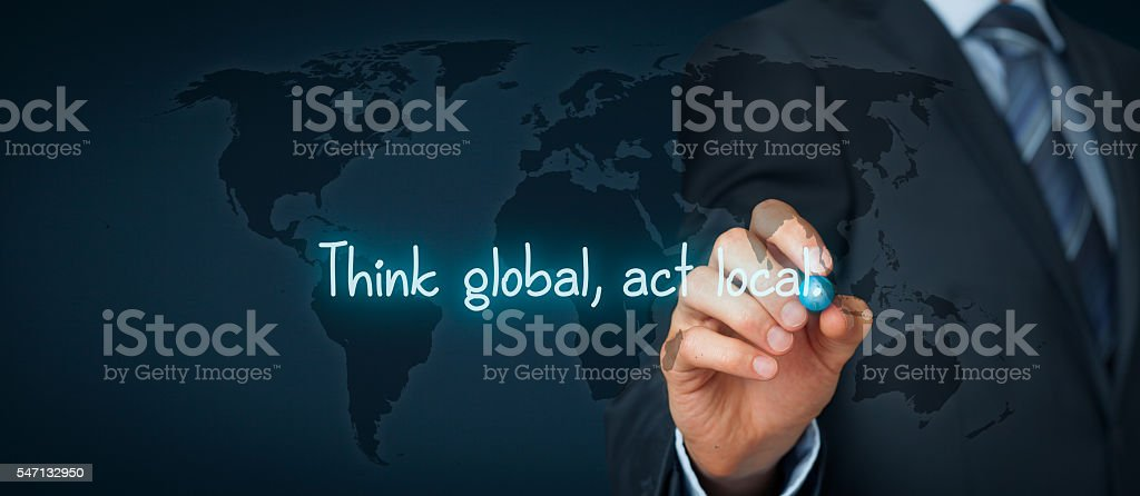 Think global act local Think global, act local. Globalization business rule. Businessman write rule on virtual board. Wide banner composition. Adult Stock Photo