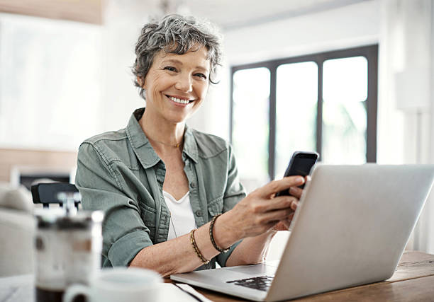 think it's about time i made some plans - older woman phone stock photos and pictures