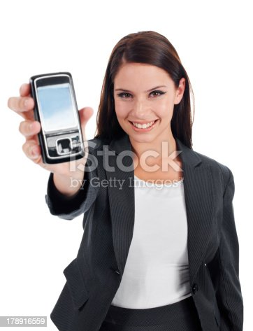 Studio shot of an attractive young woman holding up a cellphone to the camera isolated on white