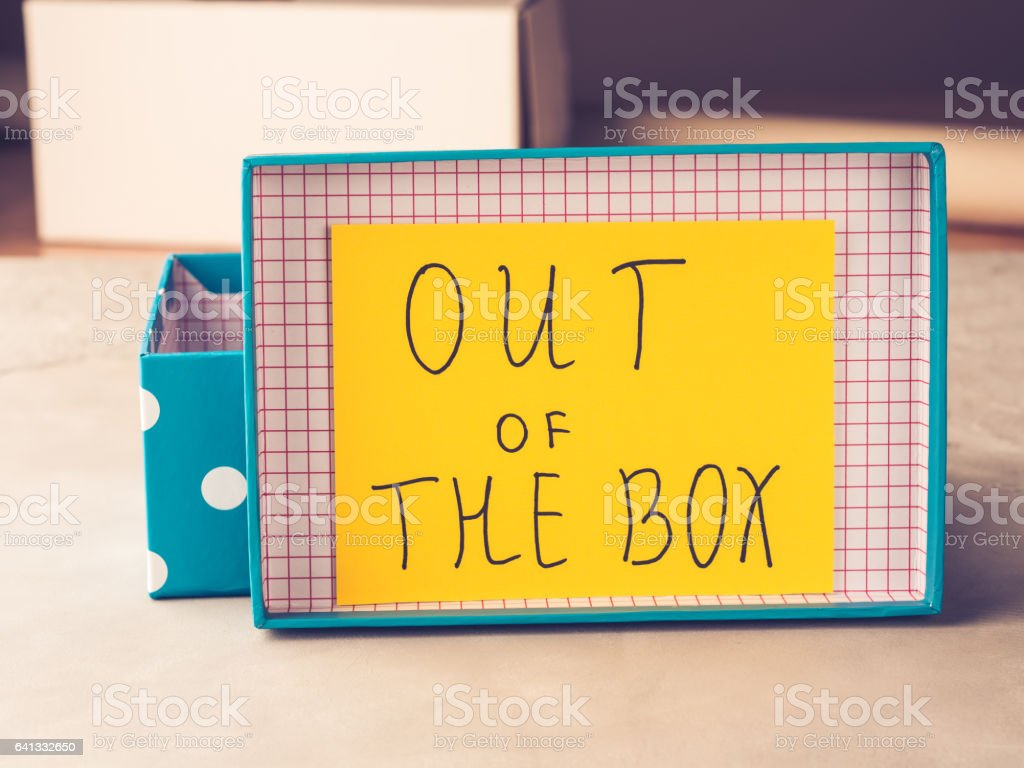 Think out of box concept yellow card stock photo