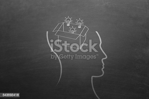 istock Think outside the box concept on blackboard. 543593418