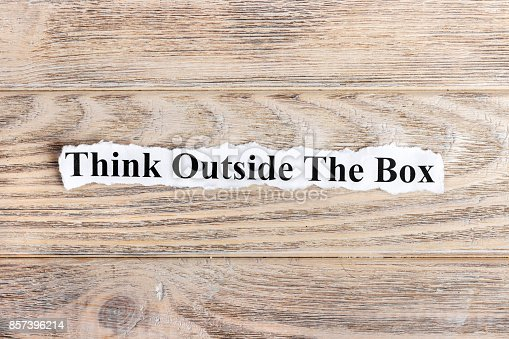 istock Think Outside The Box text on paper. Word Think Outside The Box on torn paper. Concept Image 857396214