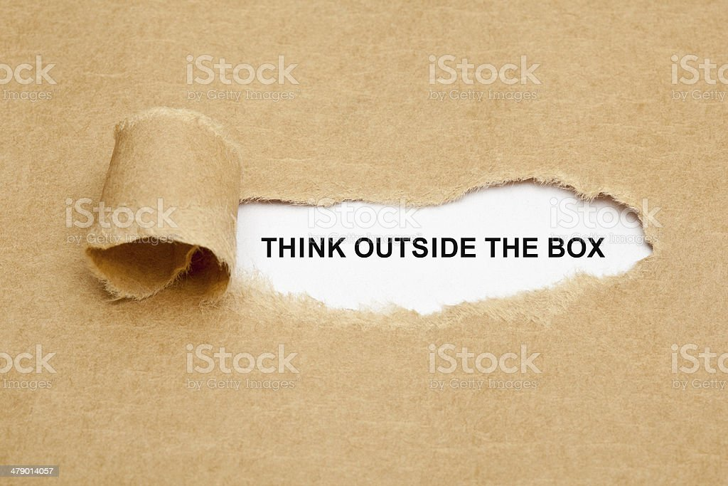 Think Outside The Box Torn Paper stock photo