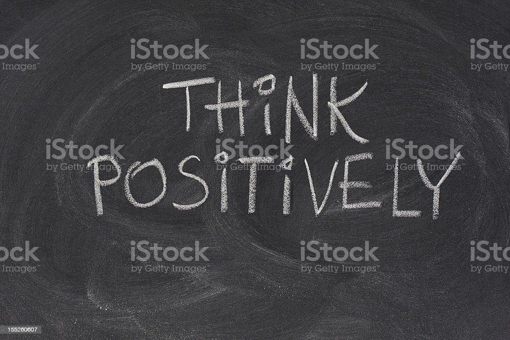 think positively slogan on blackboard royalty-free stock photo