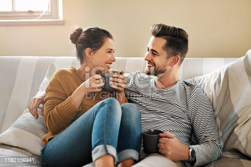Cropped shot of a young couple relaxing on the sofa at home