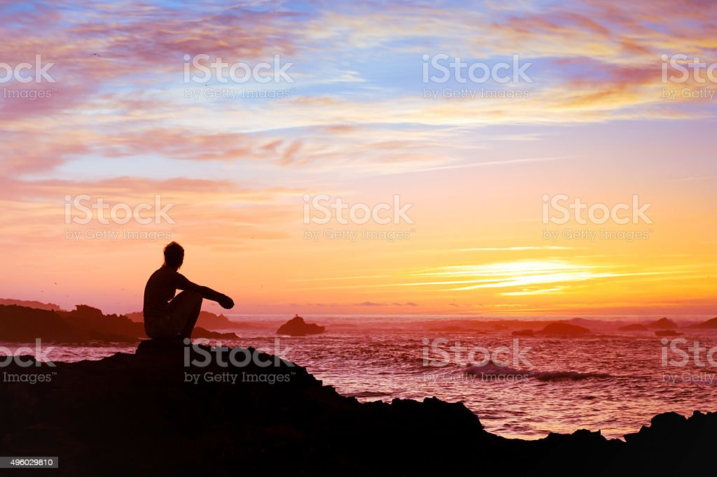 thinking about the meaning of life stock photo