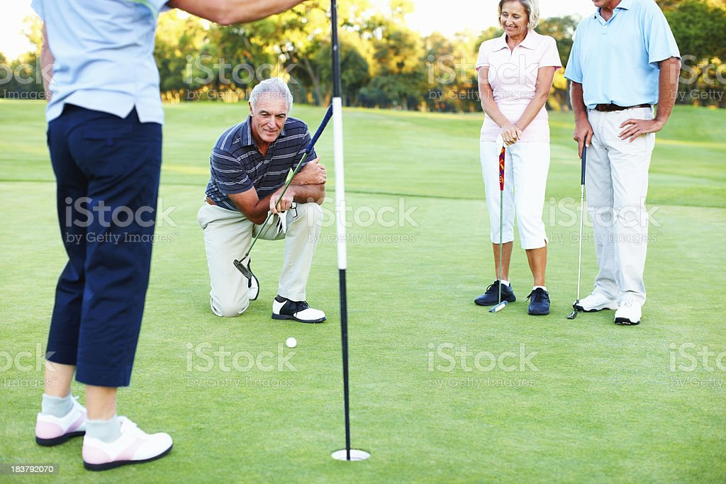 Thinking about the putt stock photo
