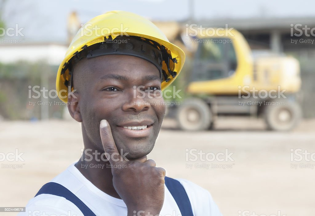 Thinking african worker has an idea stock photo
