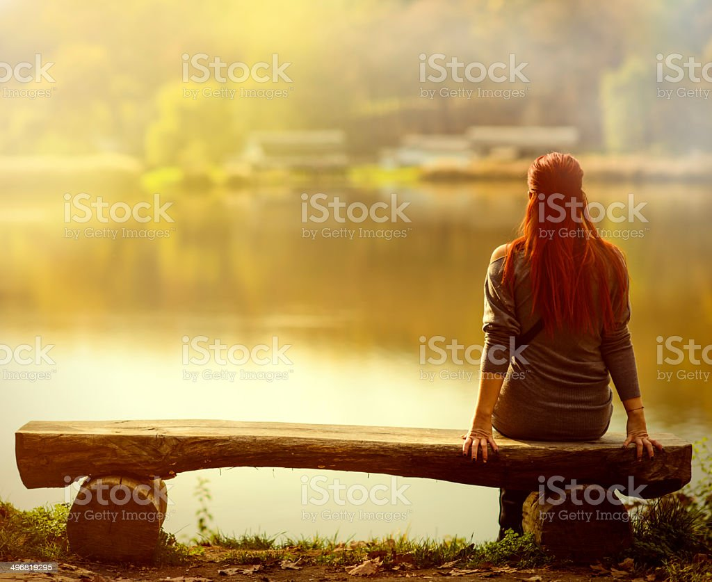 thinking alone stock photo