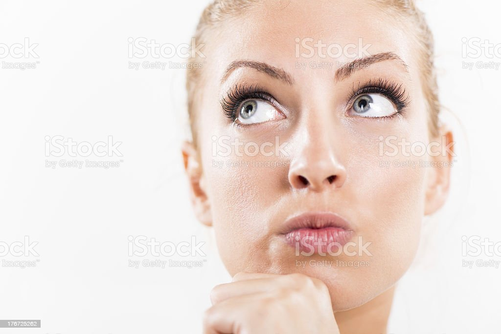 Thinking and looking up royalty-free stock photo