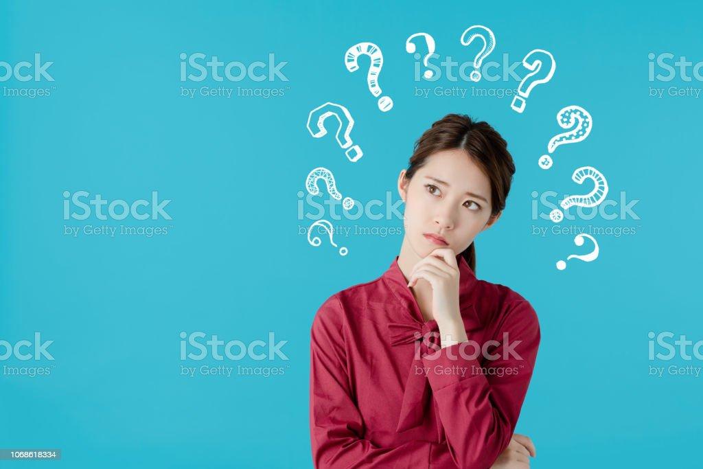 Thinking asian woman. stock photo