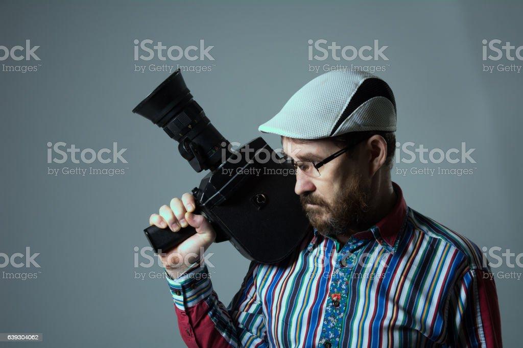 Thinking bearded man old retro film camera. stock photo
