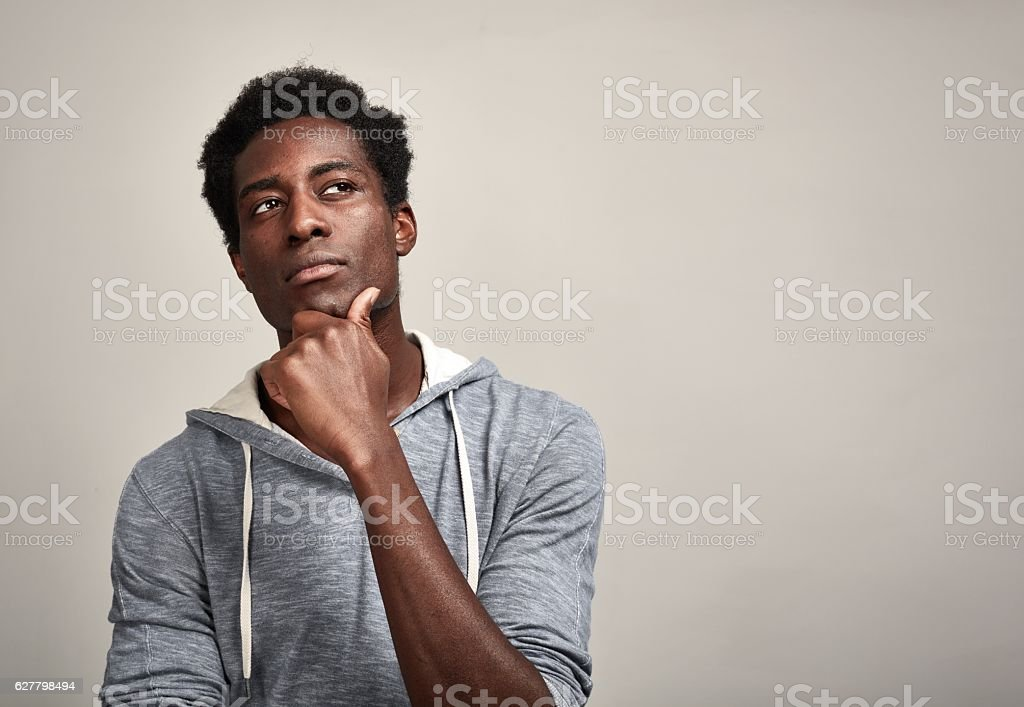 Thinking black man stock photo