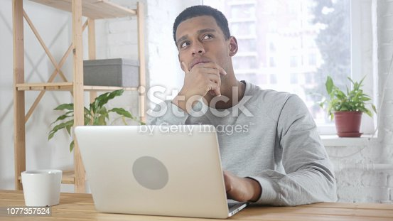 istock Thinking, Brainstorming Sad Young Afro-American Man, Portrait 1077357524