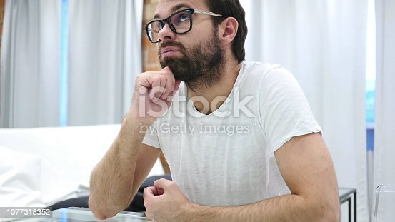 istock Thinking, Brainstorming Sad Young Beard Man, Portrait 1077318352