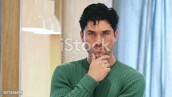istock Thinking, Brainstorming Young Handsome Man, Portrait 1077315470