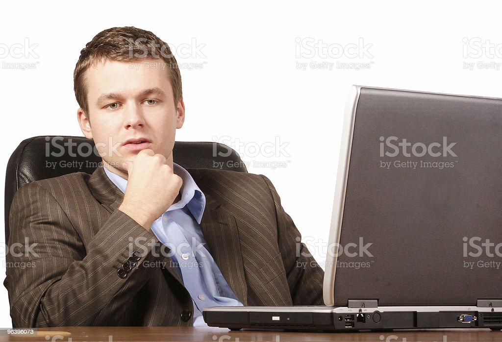 thinking business man with laptop - smart casual royalty-free stock photo