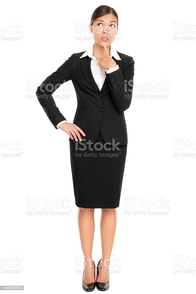 thinking business woman standing royalty-free stock photo