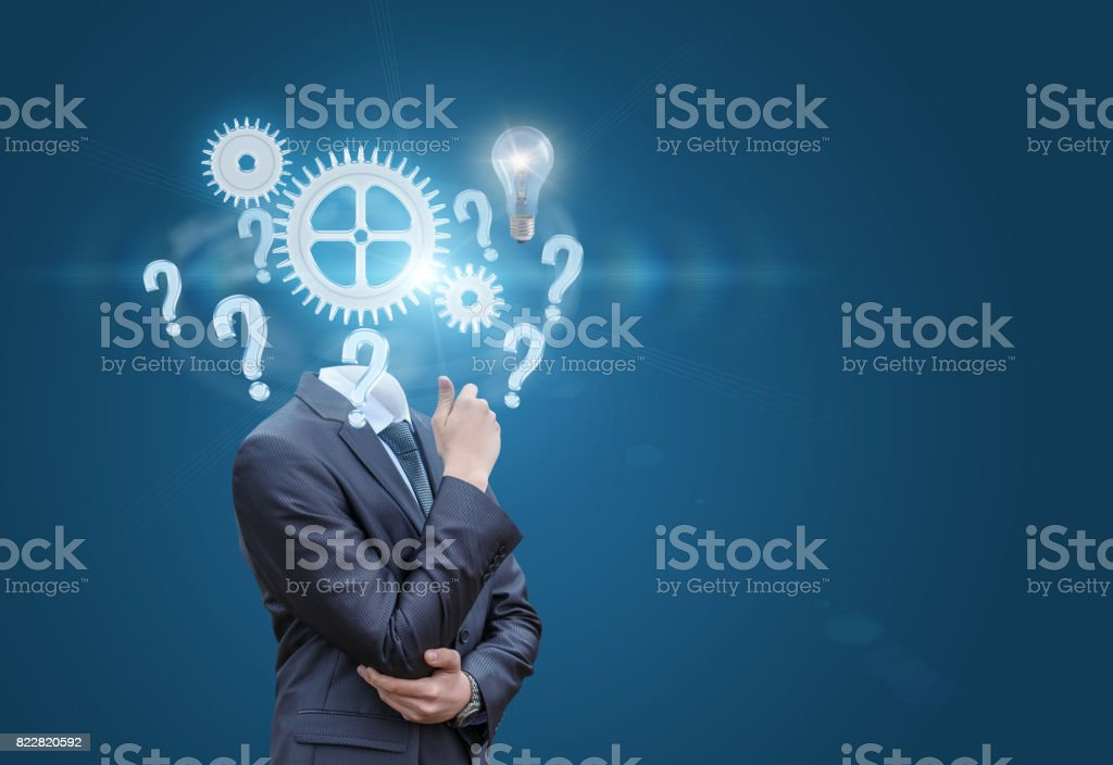 Thinking businessman on a blue background. stock photo