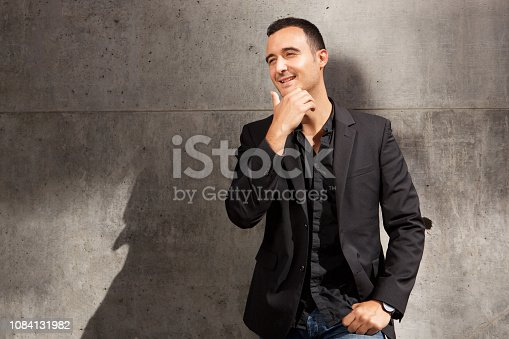 istock thinking businessman posing against gray wall 1084131982