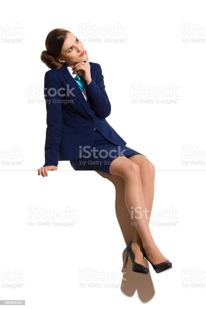 Thinking Businesswoman Is Sitting On Top Of A Banner royalty-free stock photo
