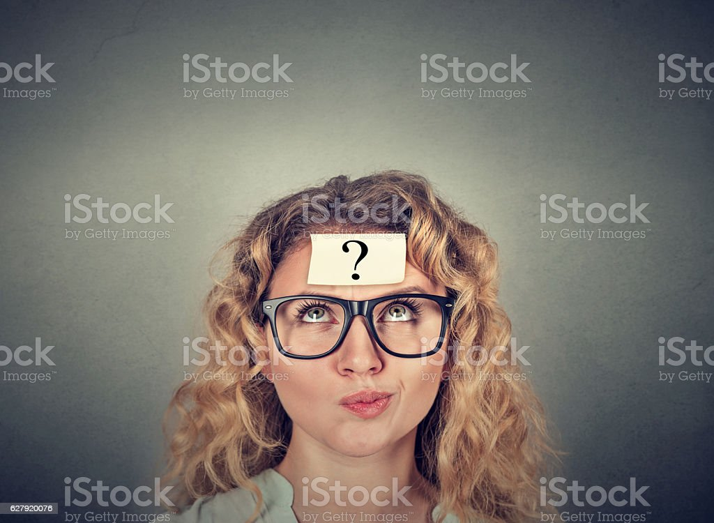 thinking confused woman with question mark stock photo