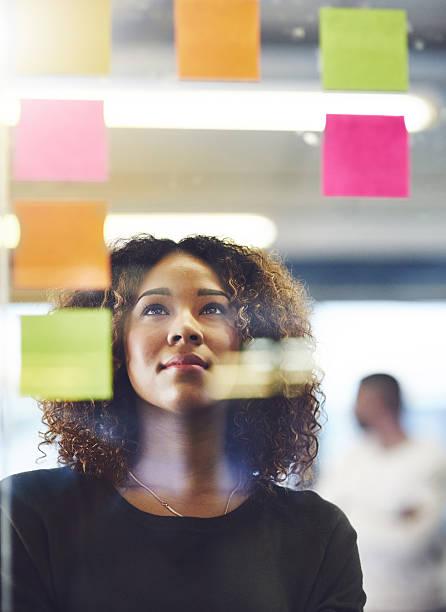thinking critically to create success - design thinking fotografías e imágenes de stock