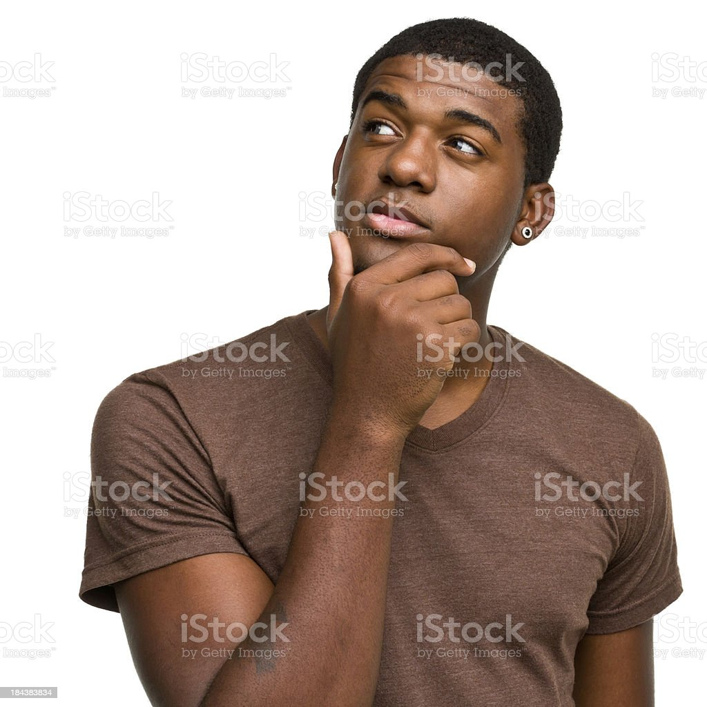 Thinking Daydreaming Young Man Looking Away stock photo